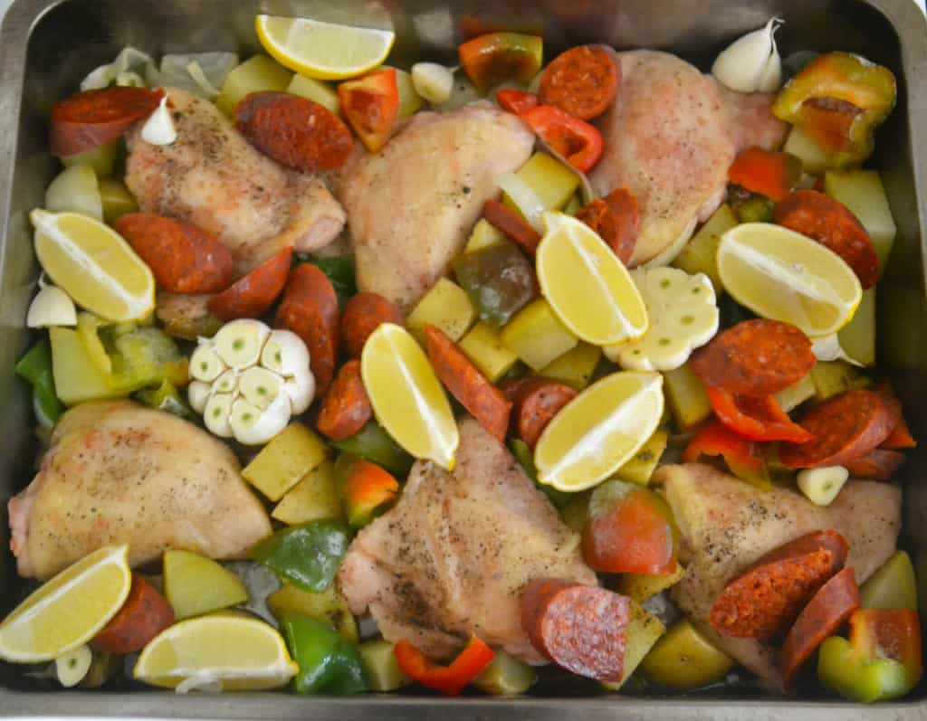 part cooked chicken with garlic, lemon, peppers and chorizo added.