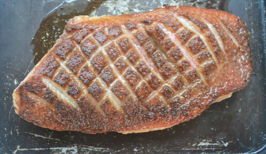 WHOLE crispy duck breast cooked.