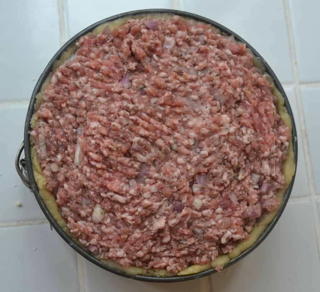 second layer of sausage meat added.