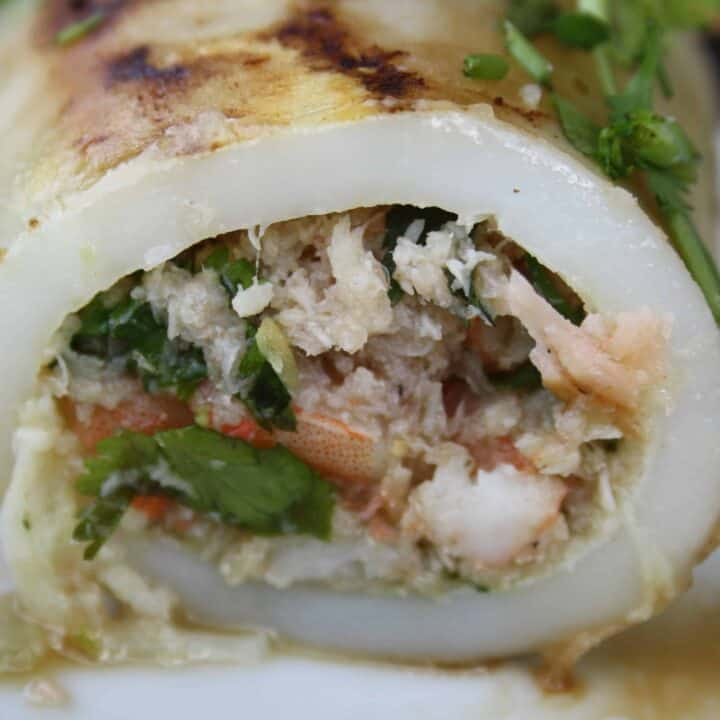 Squid tubes stuffed with cooked prawns, crab, coriander, garlic, ginger and chillies and then seared on a hot grill for a fantastic low fat dish.