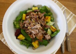 Warm duck salad with a lemon and lime dressing. Slow roasted duck legs andt, griddled fresh pineapple and combines with cucumber and mixed salad leaves.