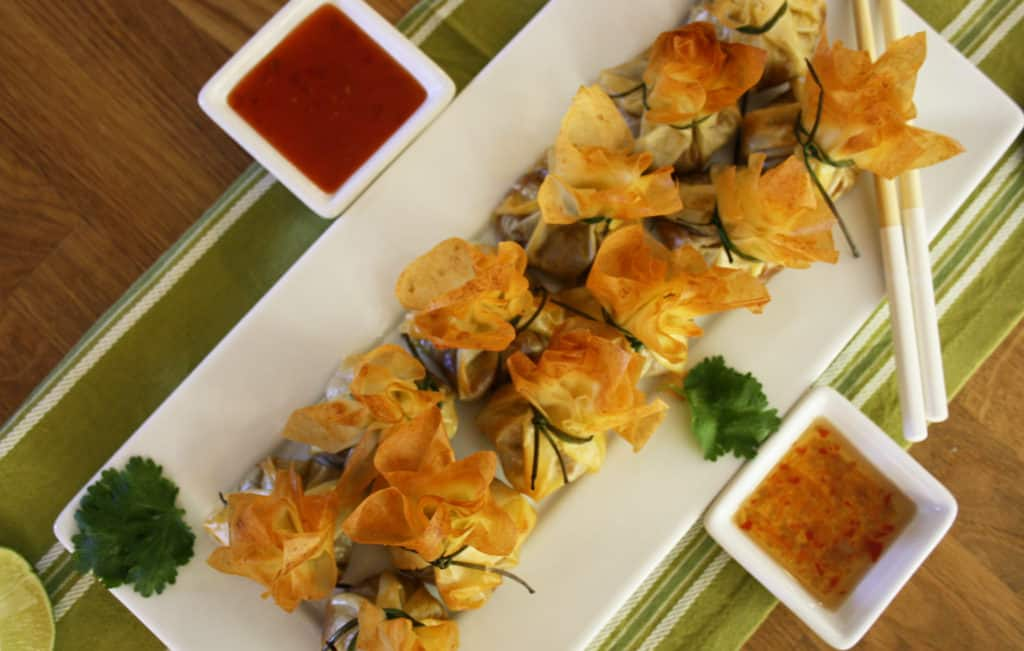 Pork mince, flavoured with Thai red curry paste, garlic, coriander and peanut butter and baked in filo moneybags tied with chives.