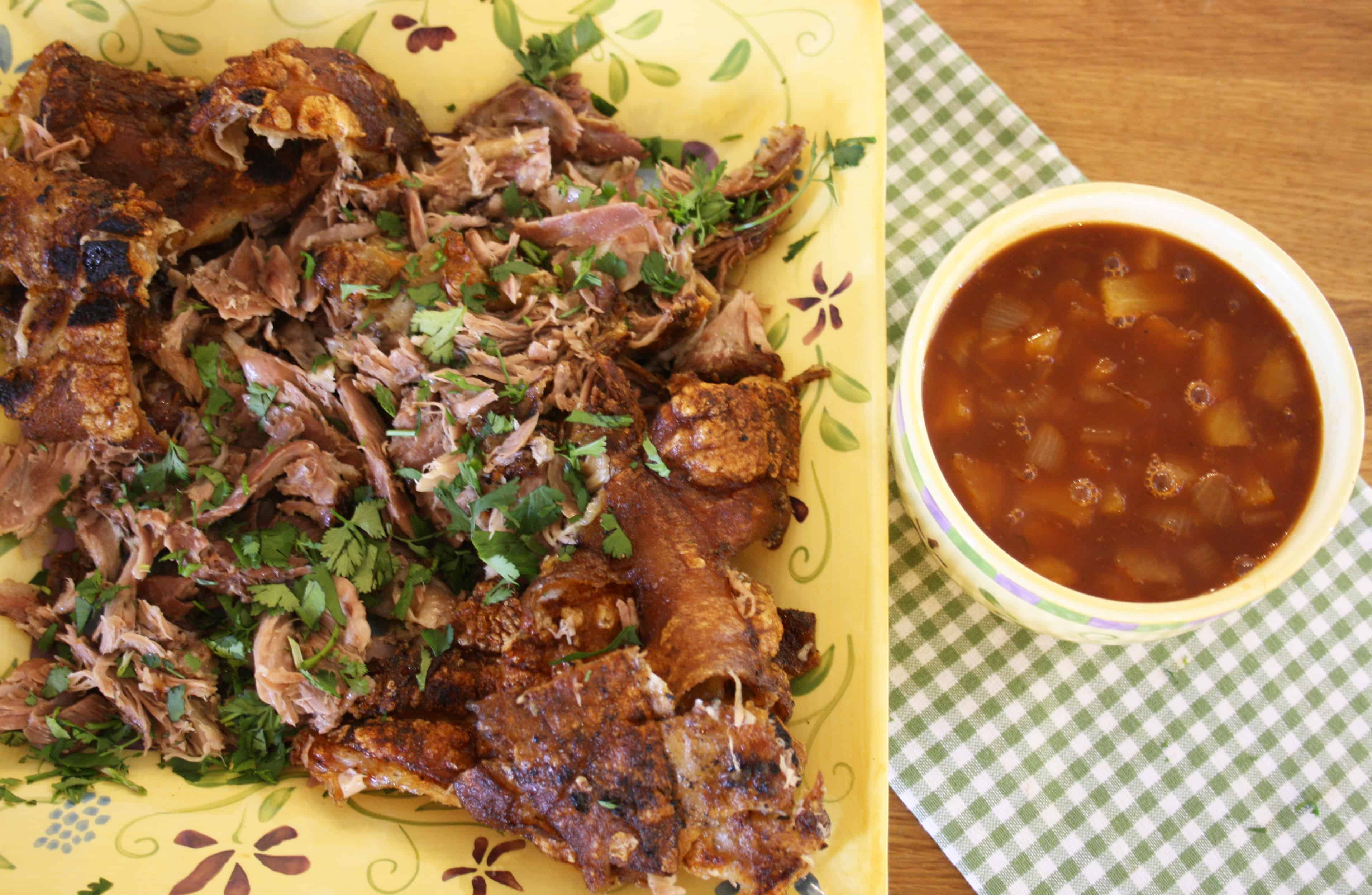 Pork shanks, rubbed with paprika and seasoning, slow roasted and then crisped up on the barbecue, shredded and served with a pineapple sauce.