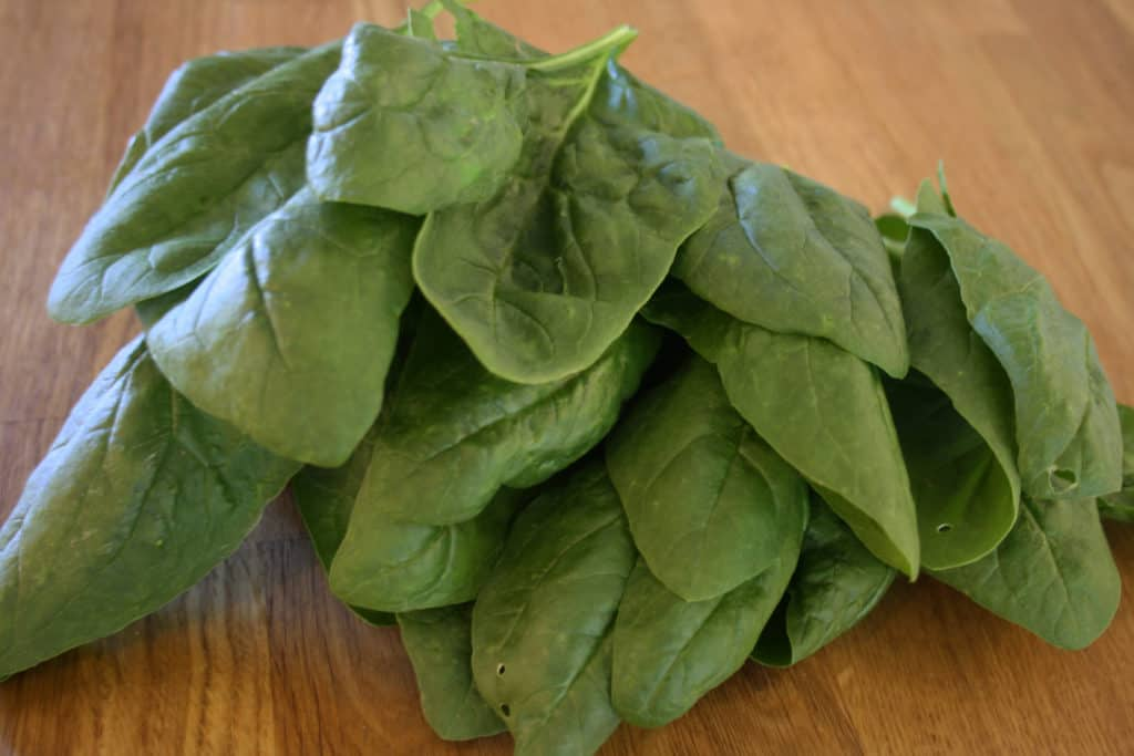 pile of fresh spinach leaves.