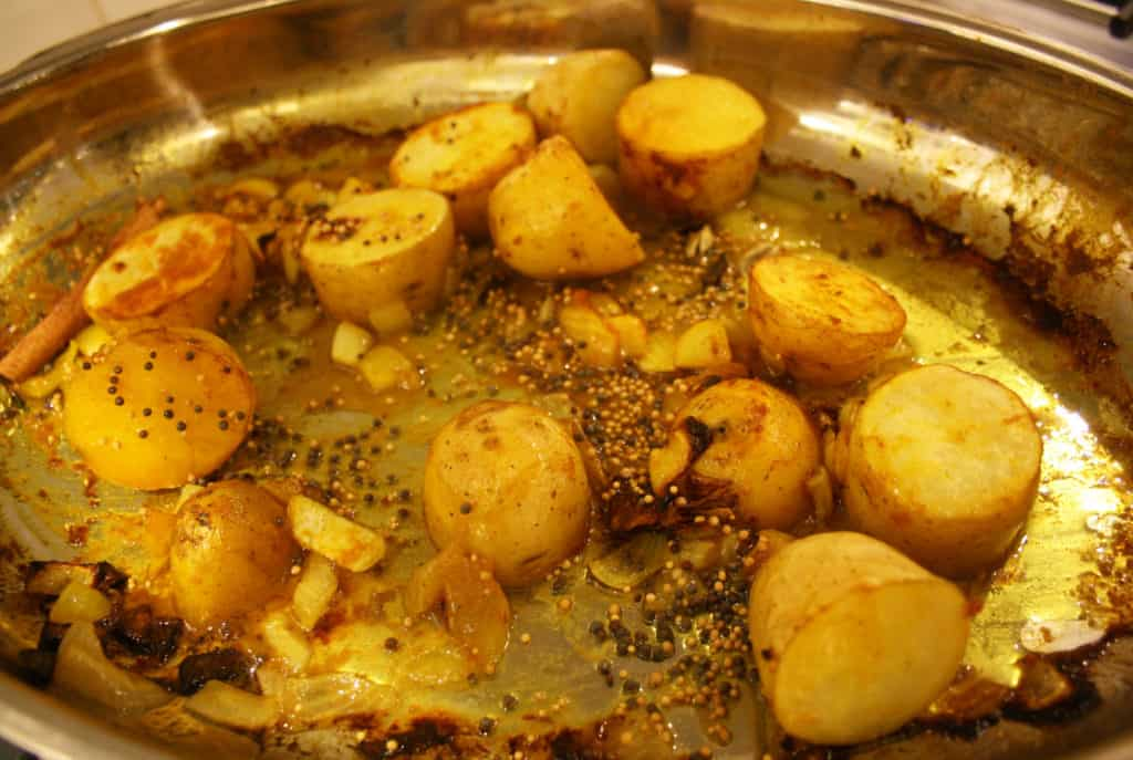 oven dish with potatoes, onions and spices