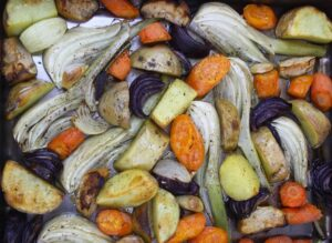 Roasted Winter Vegetables. Here's a wicked mix of garlic, fennel, potatoes, onions, apples and carrots for an easy and tasty accompaniment to roast pork.
