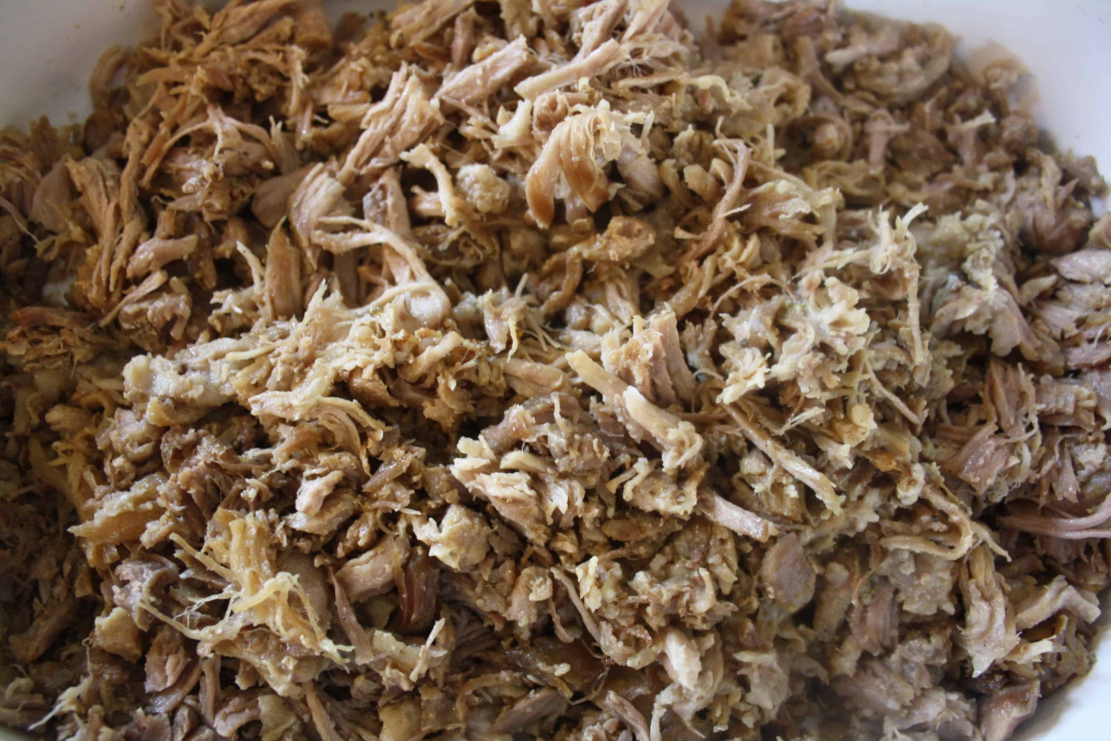 cooked shredded pork meat in a bowl.