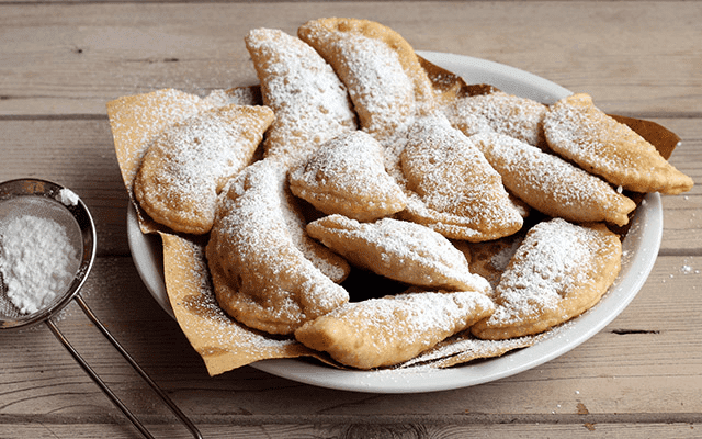 Ricotta and Chocolate Cassatelles. Chocolate and ricotta is stuffed into dumpling sized pastry and deep fried for a delicious Italian speciality.