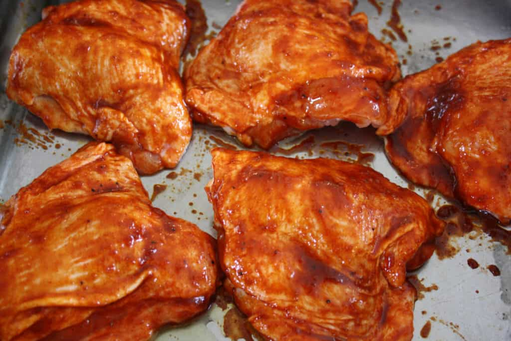 chicken thighs with the paste and honey spread over them