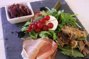 French Ploughman's. Here's my take on a British classic using goat cheese, duck confit, smoked duck, cornichons & red onion chutney for a starter or lunch.