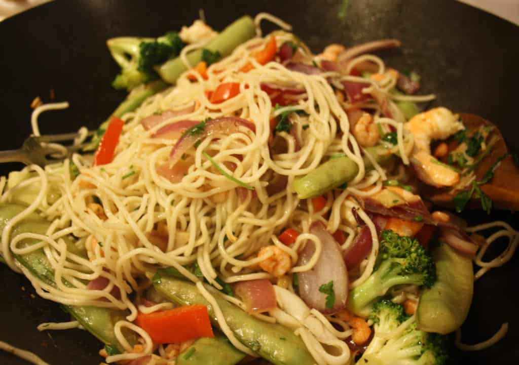 wok with noodles added.