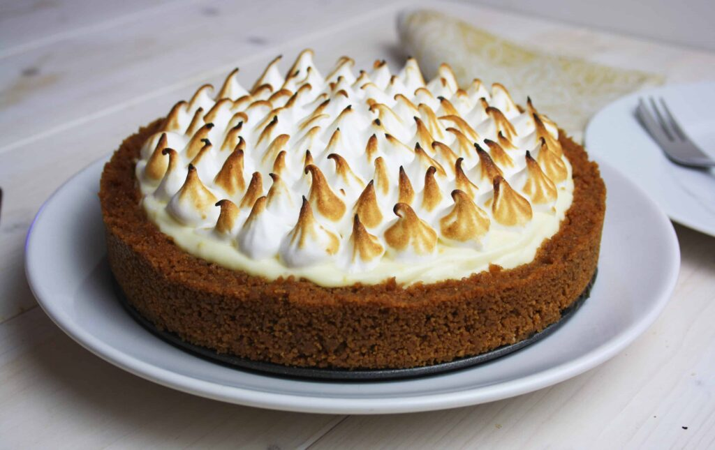 Lemon Meringue Cheesecake. This combines a no bake, no gelatin, lemon cheescake made with a speculoos crust and a meringue top.