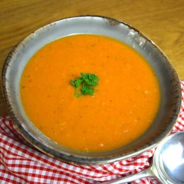 Roasted Tomato Soup with Garlic. Tomatoes and garlic roasted in the oven then combined with stock to make a simple and delicious soup.