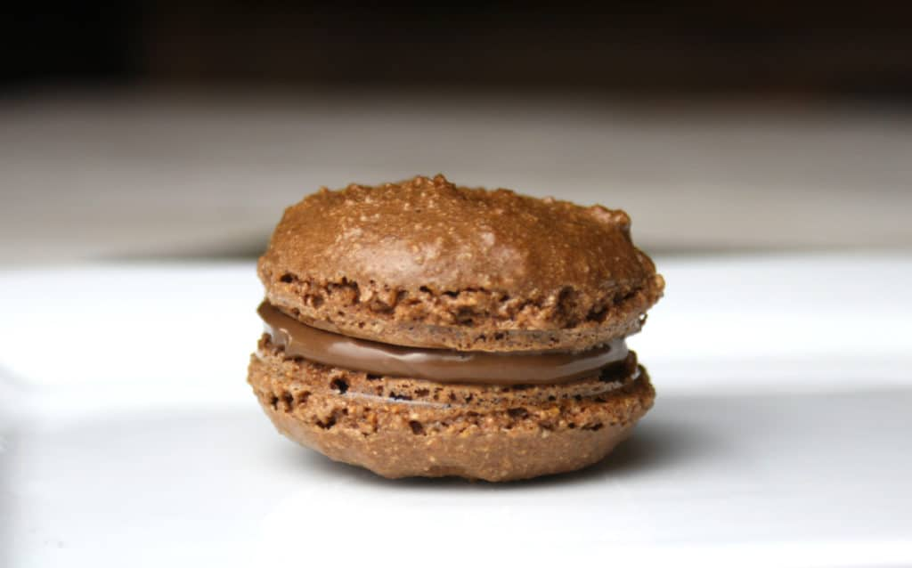Naughty Nutella Macarons are a must try if you love Nutella. This simple recipe is easy to put together and is certain to wow your guests.