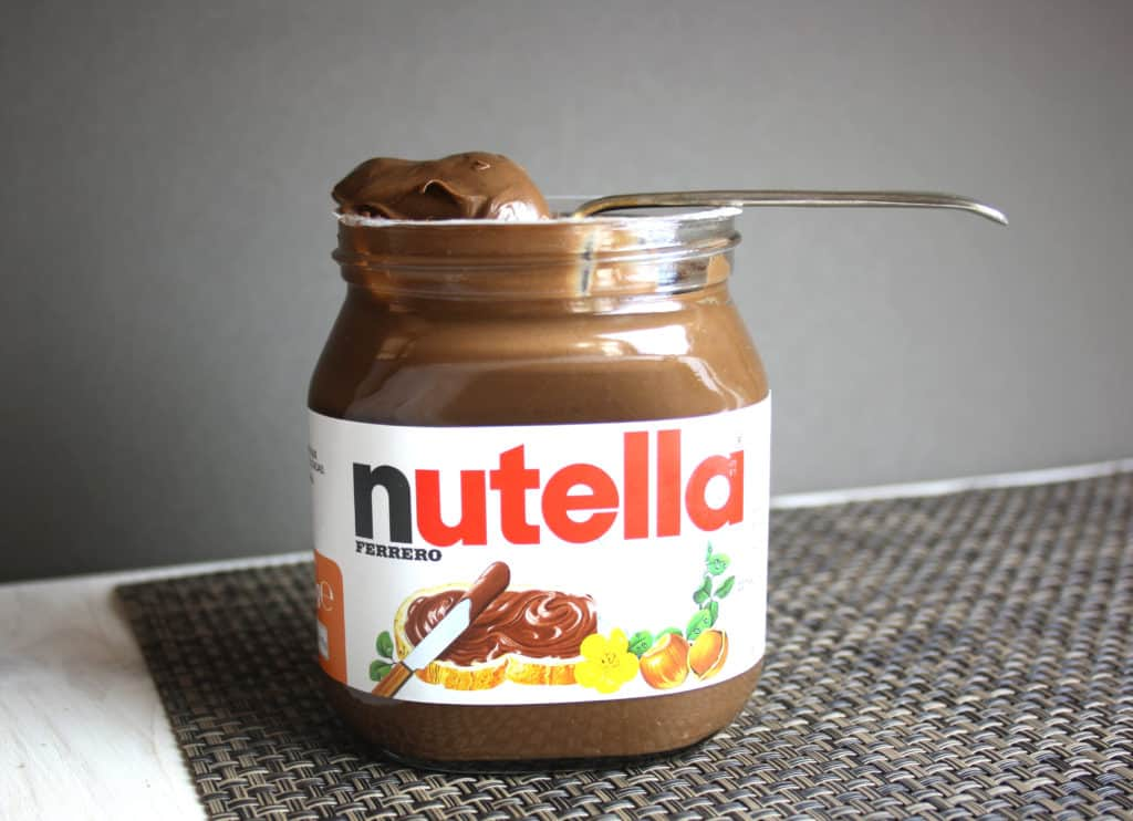 jar of nutella with a spoon in it