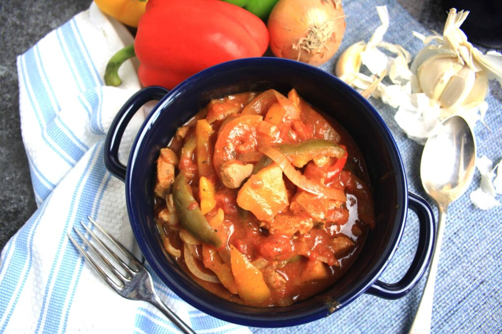 Slow Cooked Paprika Pork. Tasty pork shoulder stewed with peppers, onions and pineapple in a smoked paprika tomato sauce.