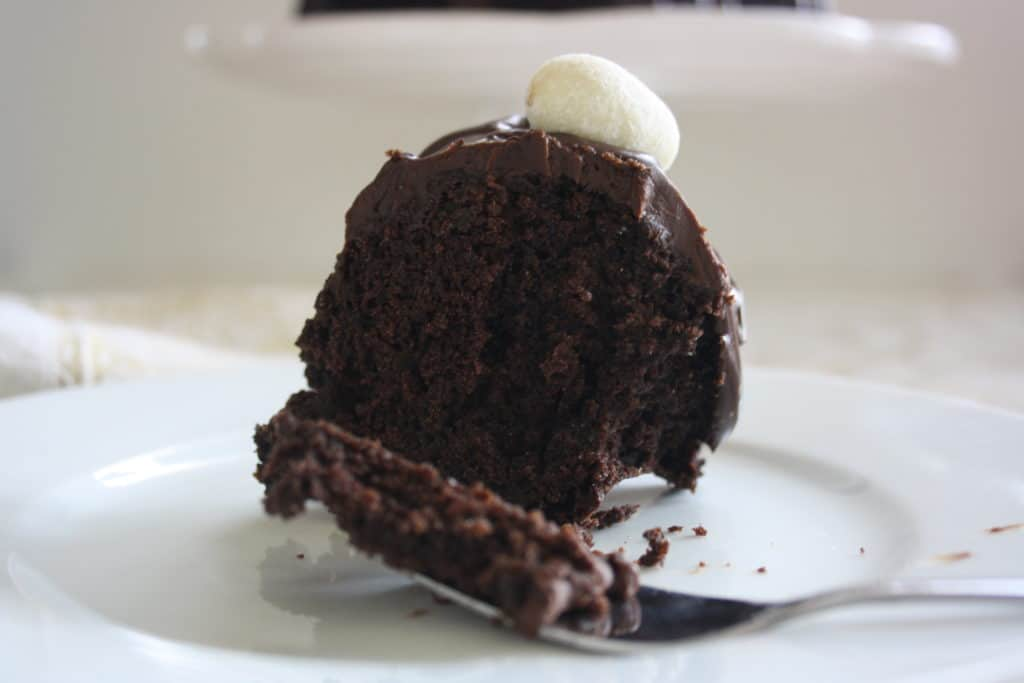 slice of cake and a fork with cake on it.