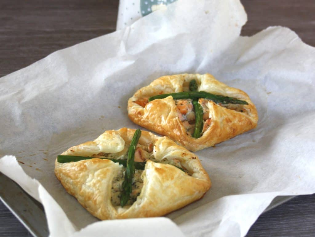 Salmon and Asparagus Puff Pastry Parcels. Poached salmon is mixed with Ricotta cheese, enveloped in puff pastry spread with basil pesto then baked.