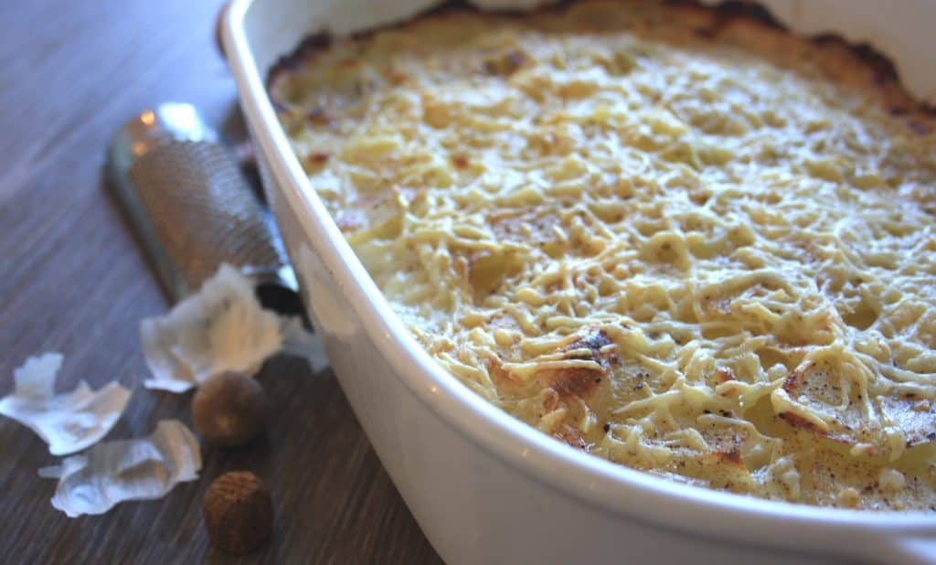 French Potatoes Gratin Dauphinoise with Bacon. A classic favourite made with scalloped potatoes, garlic, milk and cheese for a delicious side dish.