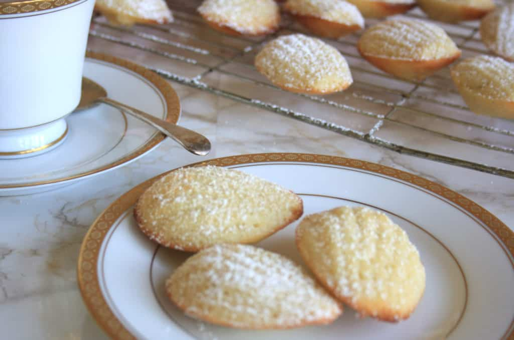 French Madeleines with Cardamom and Lime. Super light sponge cakes baked in a shell mould, dusted with icing sugar and served warm for this French classic.