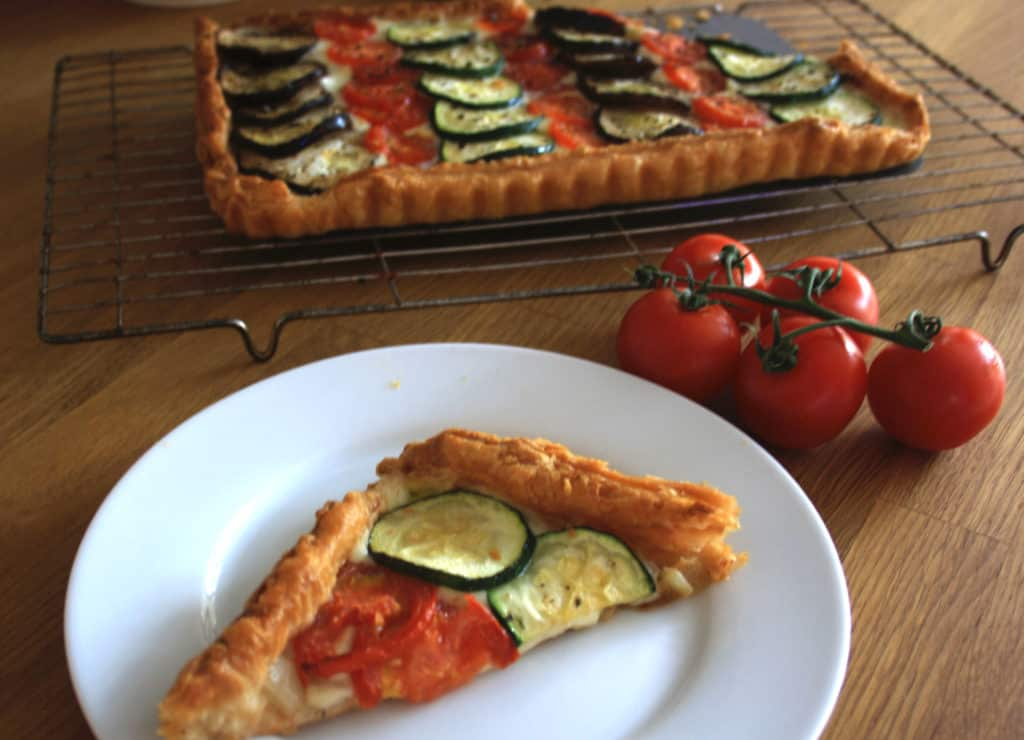 Vegetable Mozzarella Tart. Puff pastry topped with yummy mozzarella then slices of aubergine, courgette and tomato before being baked until bubbling.
