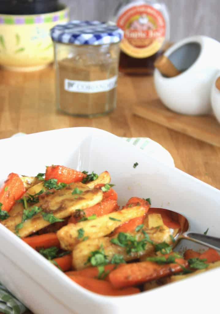 Coriander and Cumin Roasted Root Vegetables. Carrots and Parsnips roasted with butter, maple syrup, coriander and cumin seeds for a delicious side dish.