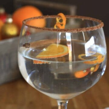 Gin-gle Bell Gin and Orange Liqueur Cocktail. Add a cinnamon and sugar crust to the glass, a few shreds of orange peel for a festive cocktail.