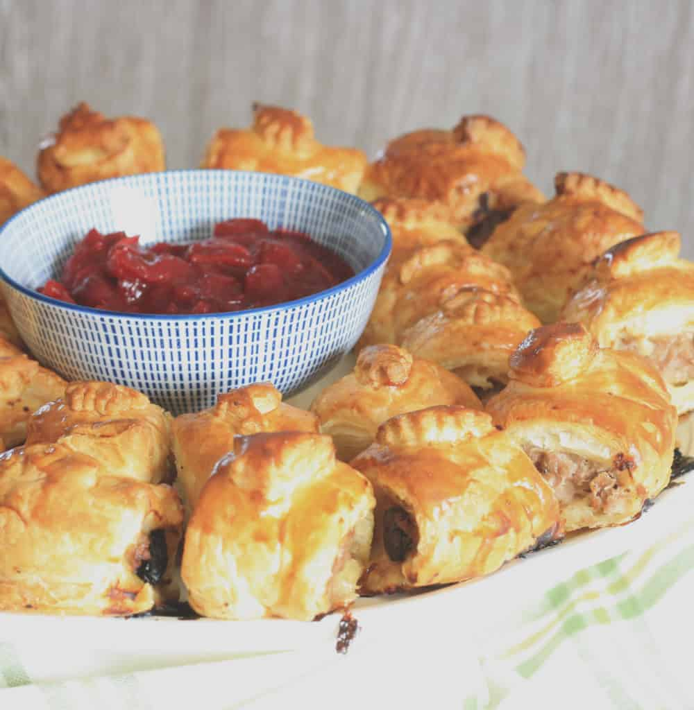 Turkey and Pork Sausage Roll Wreath. Turkey mince, cranberries and pork sausagemeat in puff pastry make a perfect dish for your New Year Buffet!