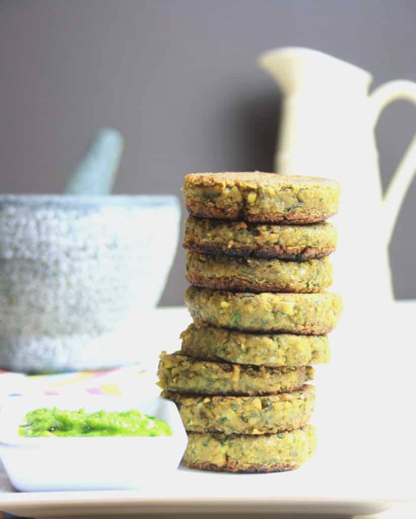 plate of falafel burgers in a stack and pesto