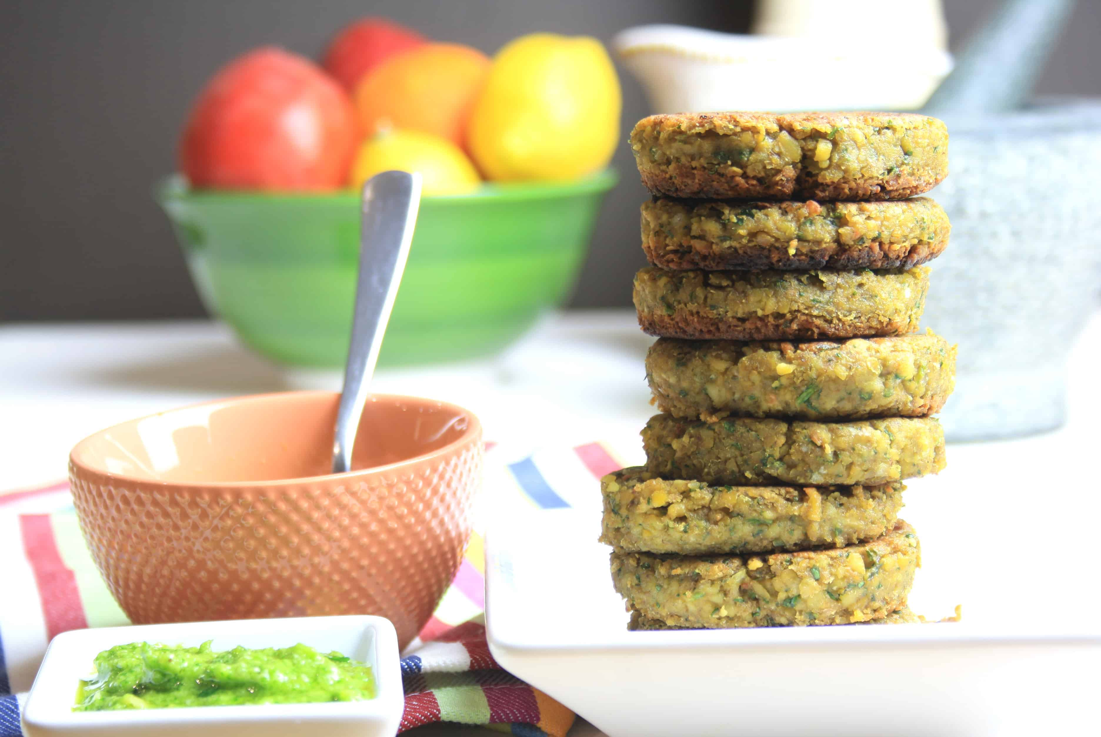 tower of falafel burgers and pot of pesto