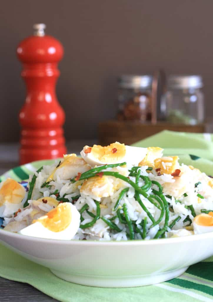 Smoked Haddock Kedgeree with Samphire. Cooked rice, just set hardboiled eggs, smoked fish and buttered samphire make this Indian-British dish delicious!