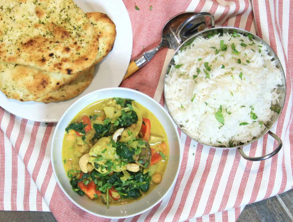picture of vegetable curry, rice and naan from overhead