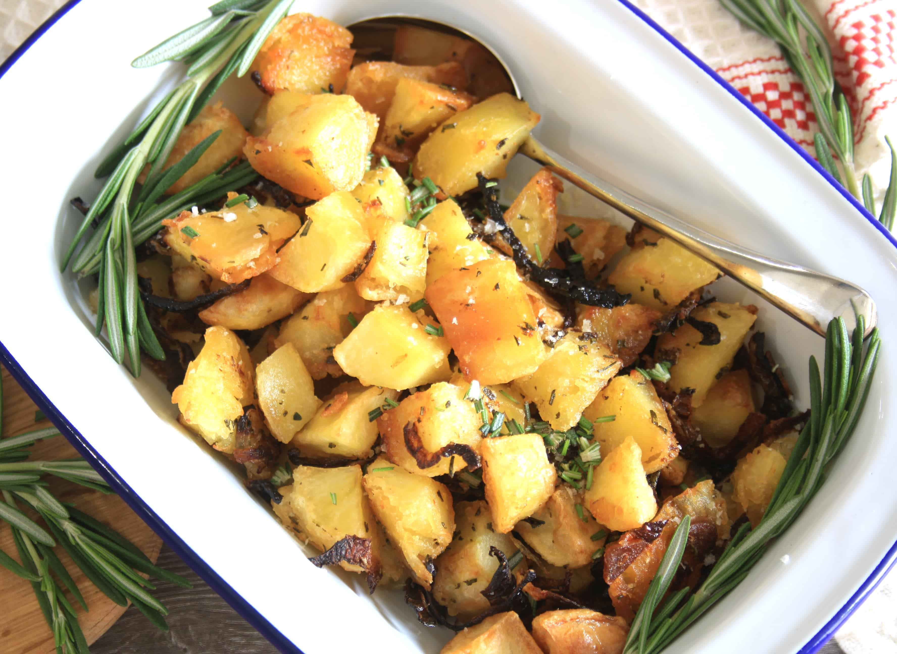 oven dish of cubed parmentier potatoes with rosemary