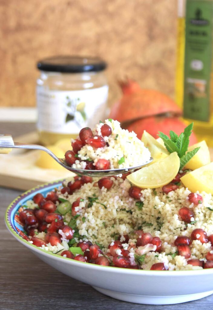 spoonful of pomegranate pistachio couscous salad