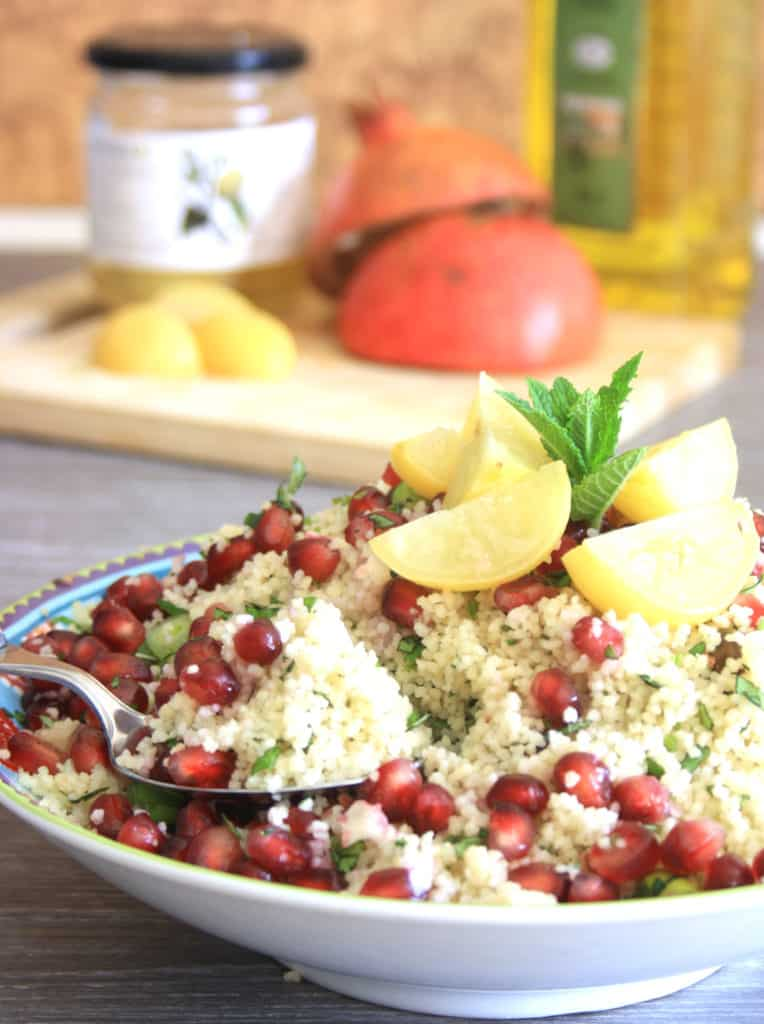 bowl of pistachio couscous with lemon garnish