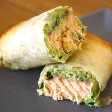 salmon and avocado parcel cut in half