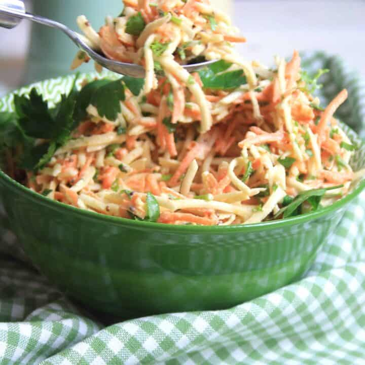 green bowl full of carrot and celeriac remoulade