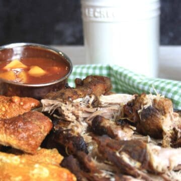 sliced pulled pork and chunks of crackling with pineapple sauce