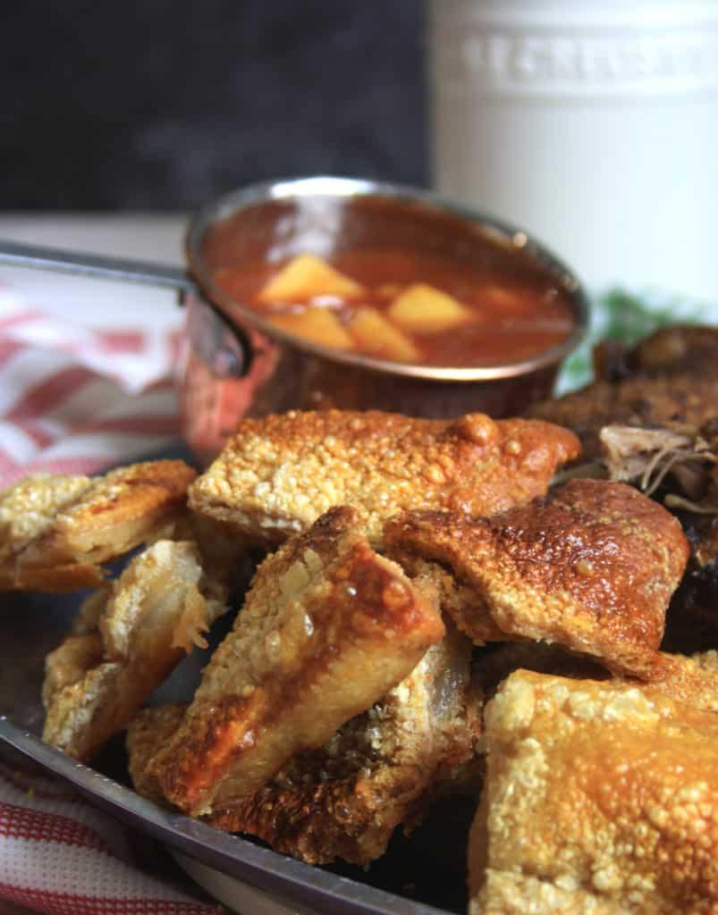 pork crackling and a pot of sauce