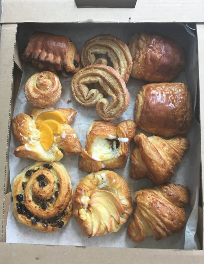 cardboard tray of assorted Danish pastries, croissants and pain au chocolat