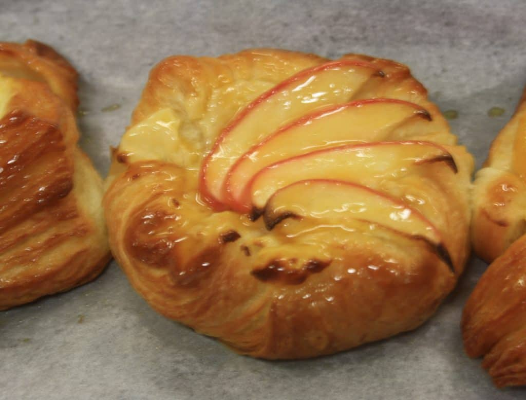 picture of danish pastry decorated with apple slices
