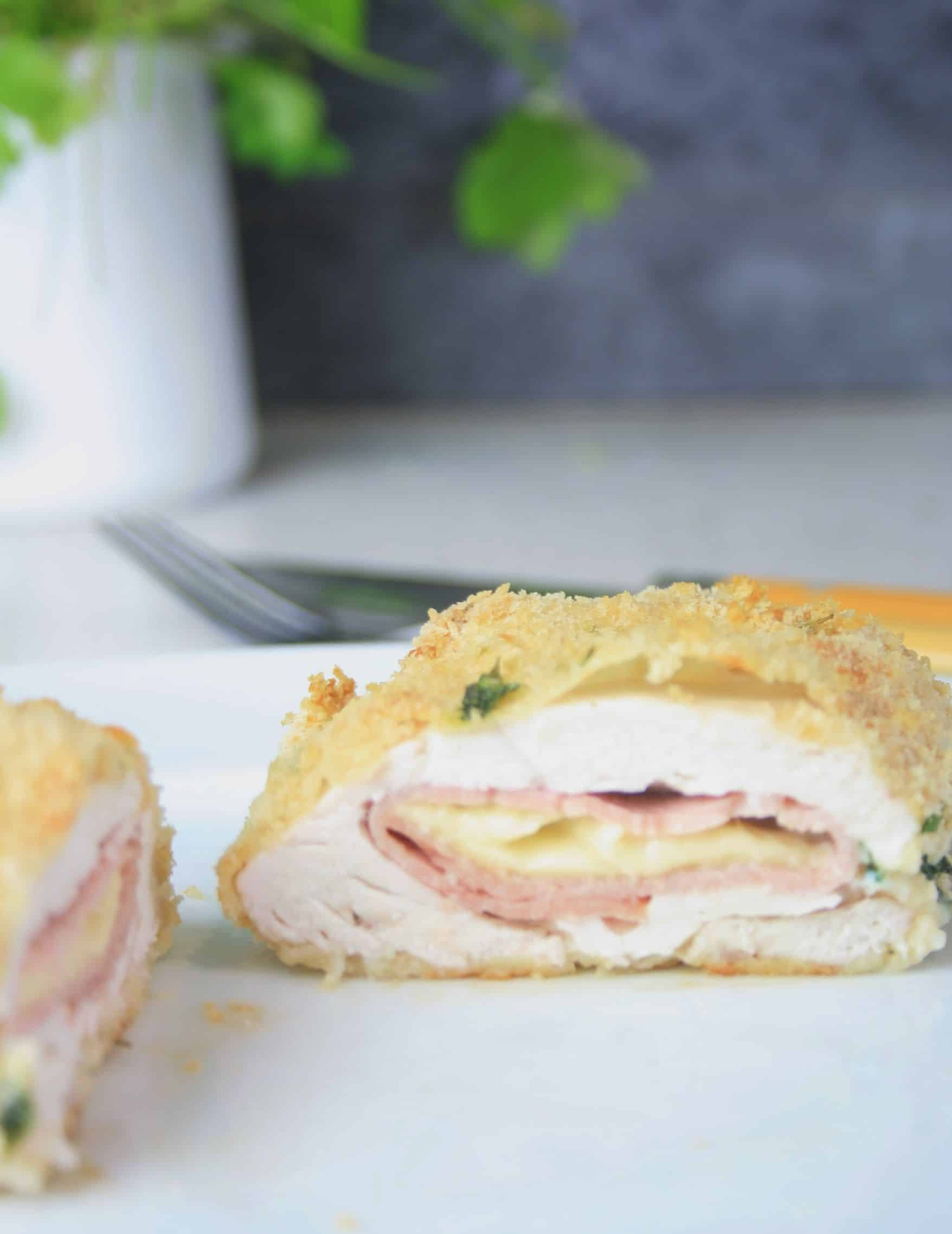 slice of cooked chicken with ham and cheese