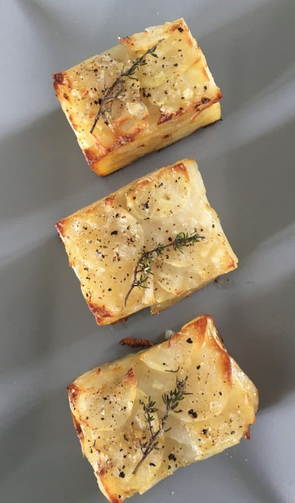 3 pices of scalloped potatoes pave