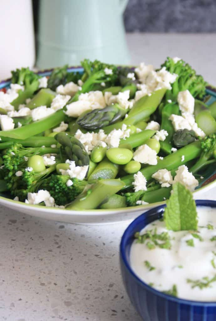 bowl of salad with yogurt dip
