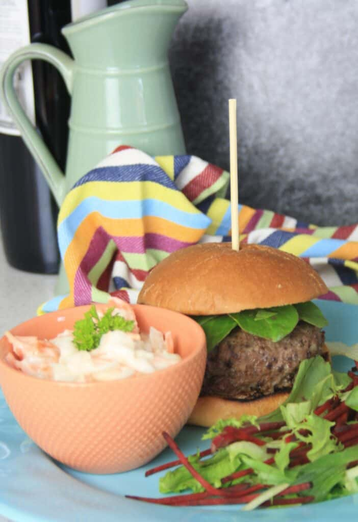 burger in a bun with coleslaw