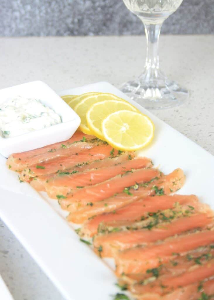 slices of gravlax with lemon