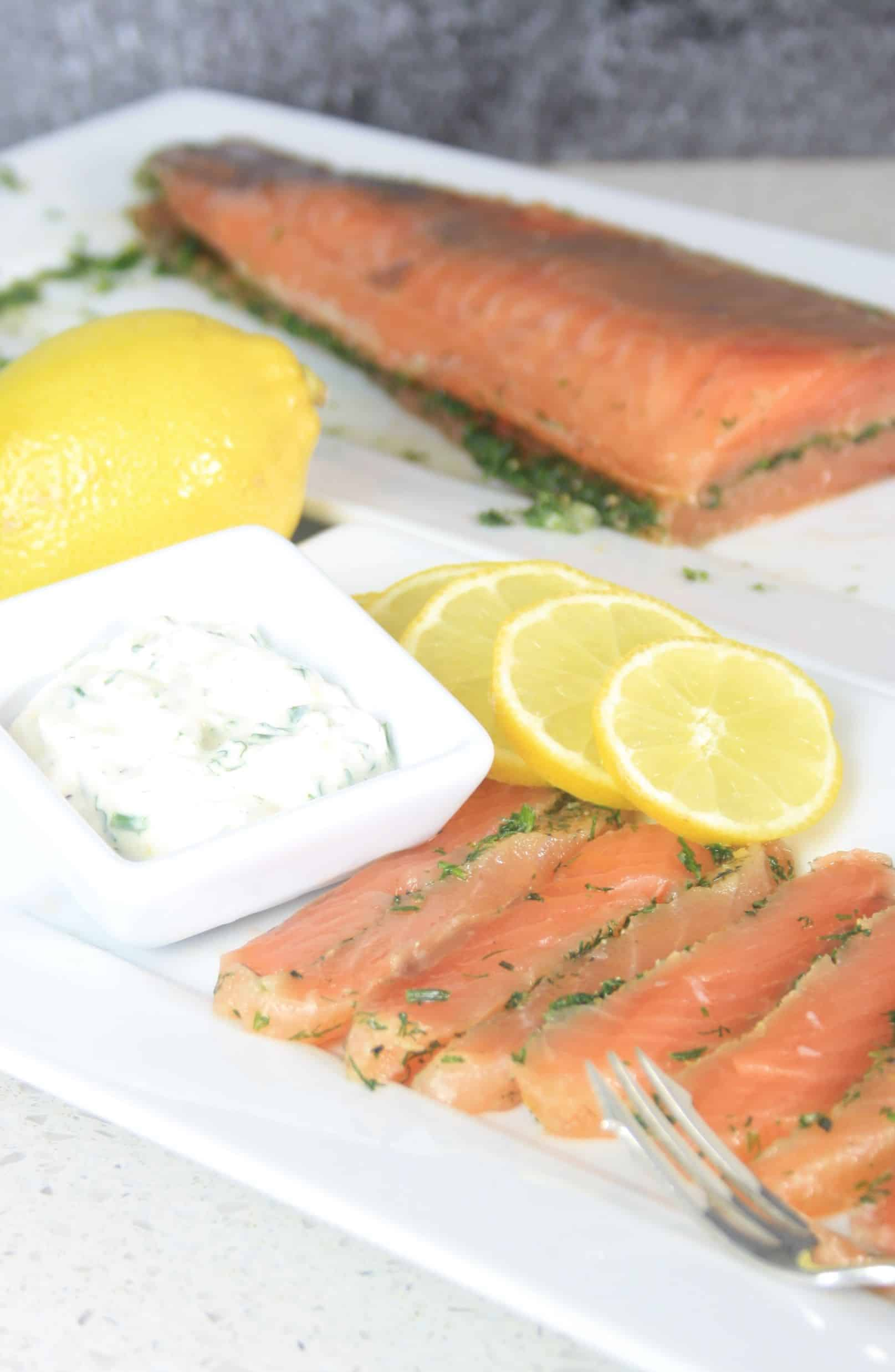 gravlax sliced with lemon