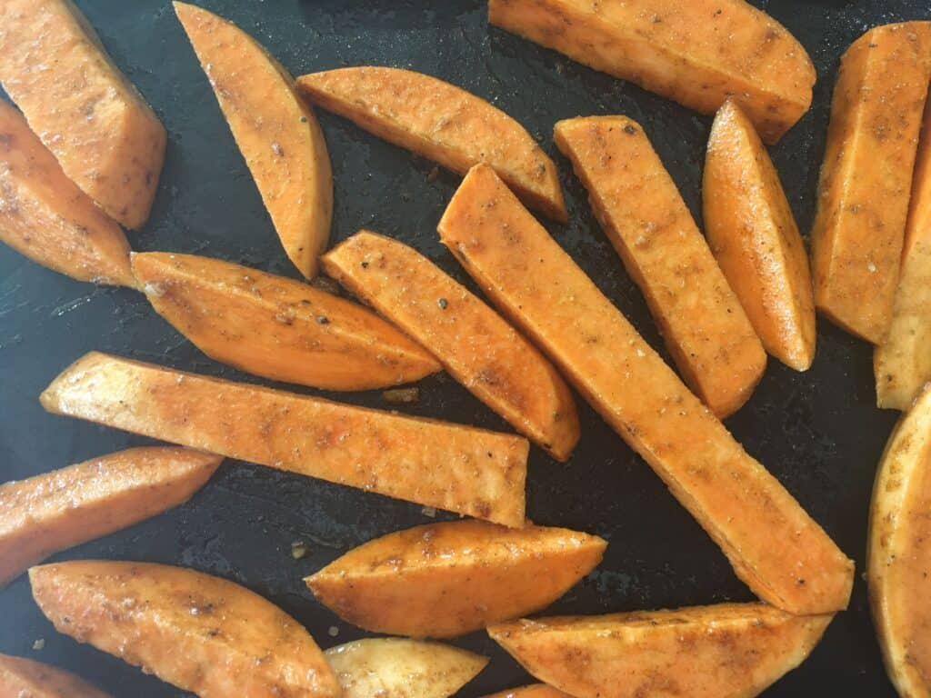chipped sweet potatoes on a baking tray