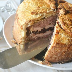 raised pie with slice cut out.