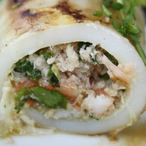 side view of squid stuffed with prawns and crab.